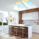Kitchen with Solar 'Fresh Air' Skylights with solar-powered blinds
