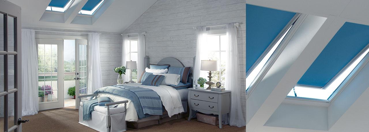 skylights with blue blackout blinds bedroom