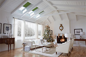 Living Room With Three VELUX Skylights Brighten Up The Space
