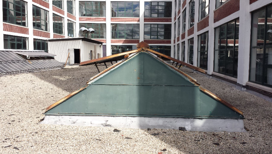 The old skylights were rusted and their glass discolored.