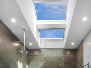 skylights in bathroom with shower head and grey interior design in perth