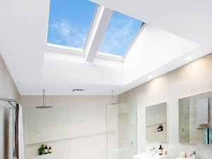 skylights in bathroom with round shower head in perth