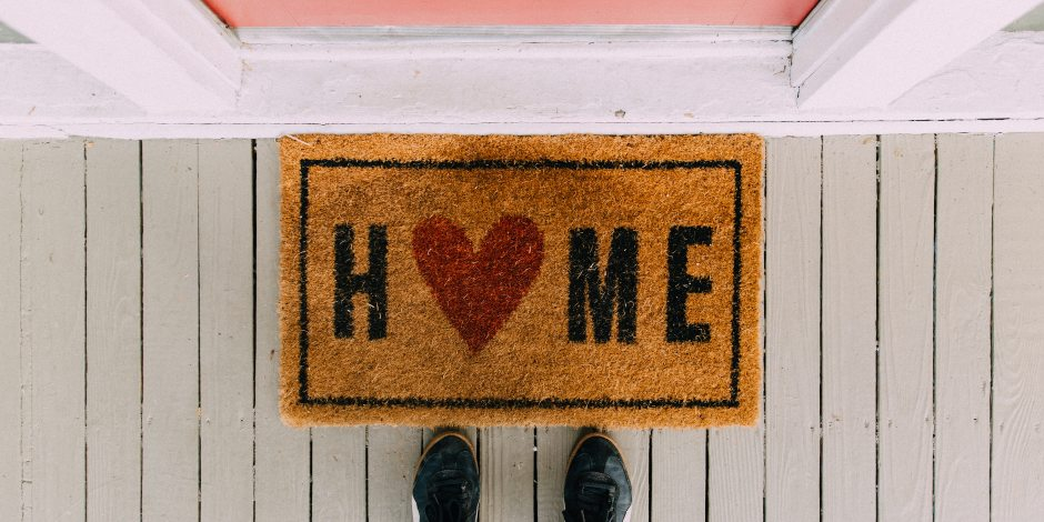 stock image of Home doormat and front door