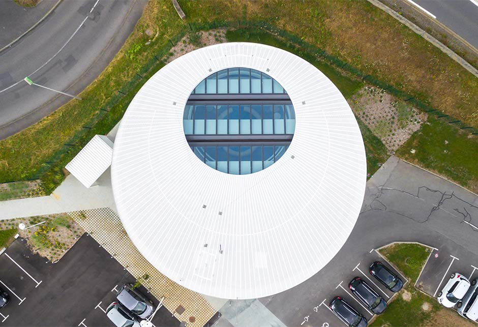 Atrium VELUX Modular Skylight solution, seen from the roof, provide a cocooning effect in the centre of the building, Somfy Lighthouse, France