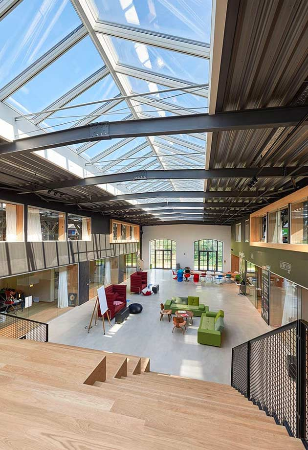 Open plan office with VELUX Ridgelight solution, Isartal railway station, Germany