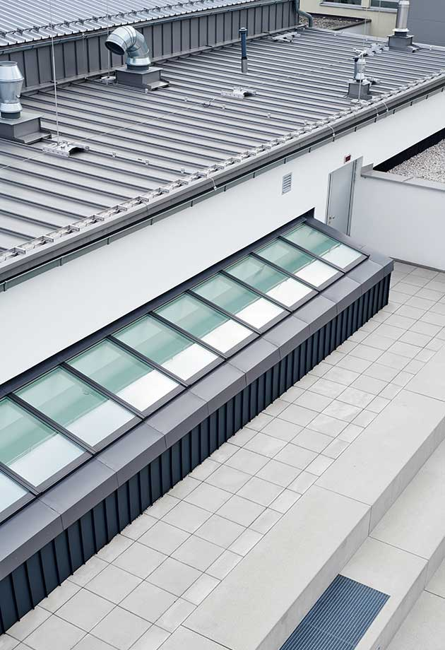 Roof view of VELUX skylight solution with Longlight 5°-30°, new school building Ebensee, Austria