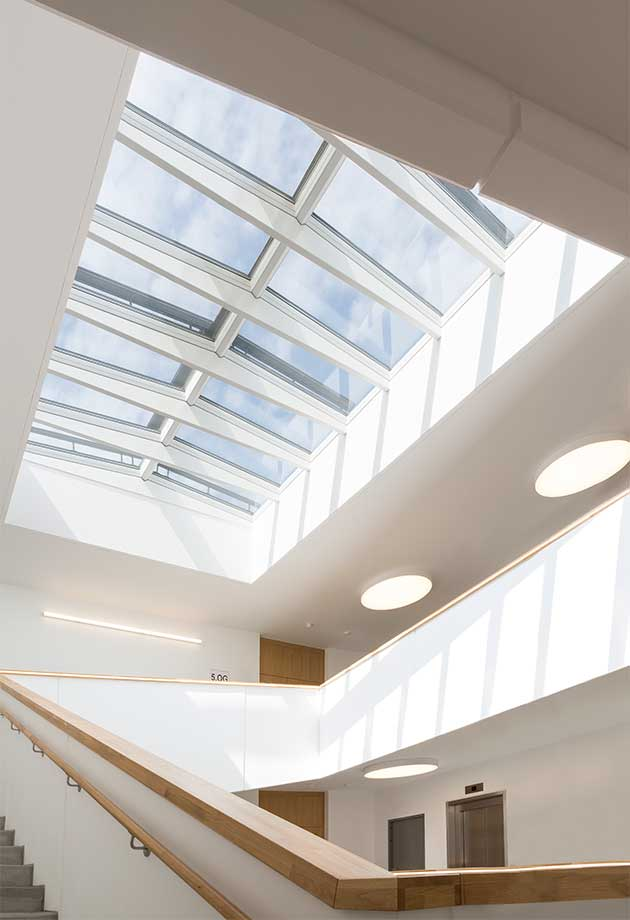 Rooflights with Ridgelight at 5° with beams in an office building in Seestadt, Vienna