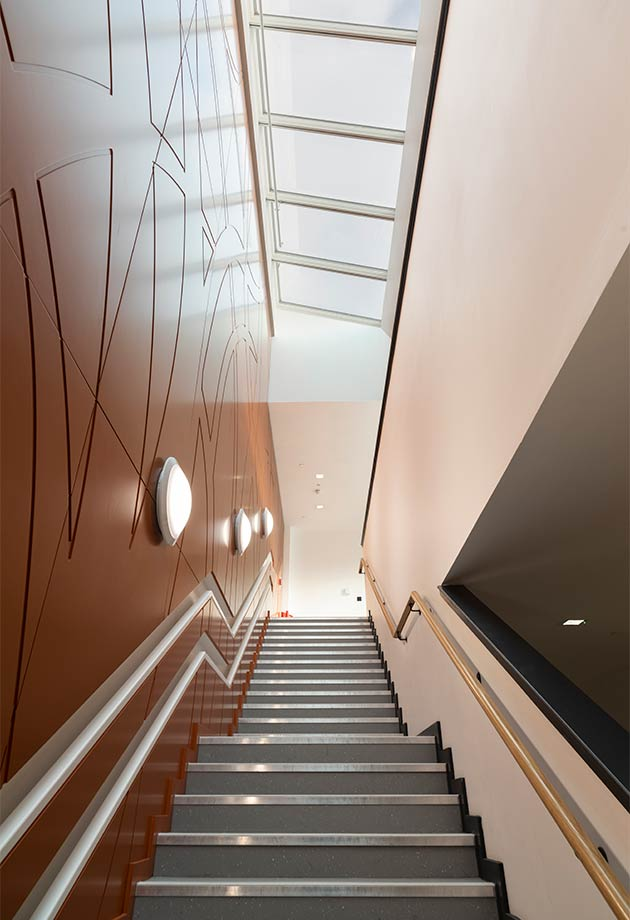 VELUX Wall-mounted Longlight solution above main circulation staircase to maximise daylight