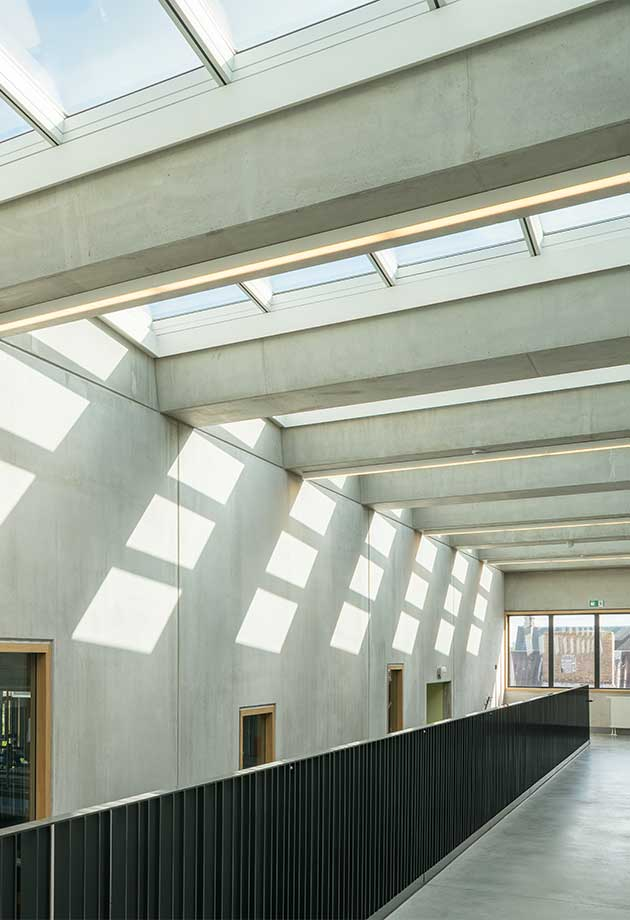 The VELUX atrium Longlight of 40 modules brings natural daylight into the large stairwell of ZAVO school, Belgium