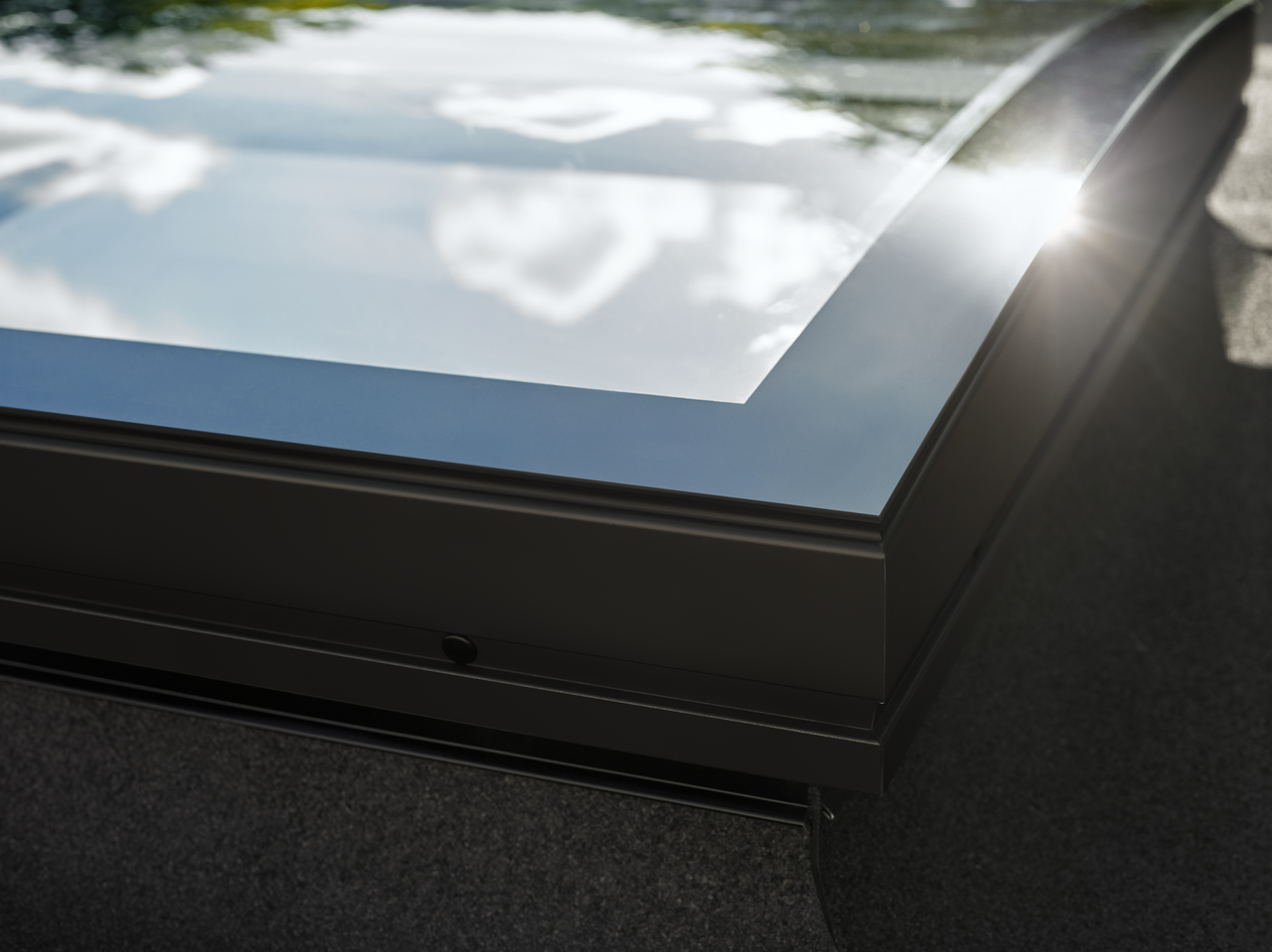 Velux curved glass rooflight let daylight shine through for Velux glass