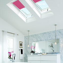 Bathroom With VELUX Skylights And VELUX Pink Blackout Blinds