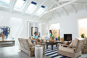 Living Room With VELUX Solar Powered Fresh Air Skylights And VELUX Blinds
