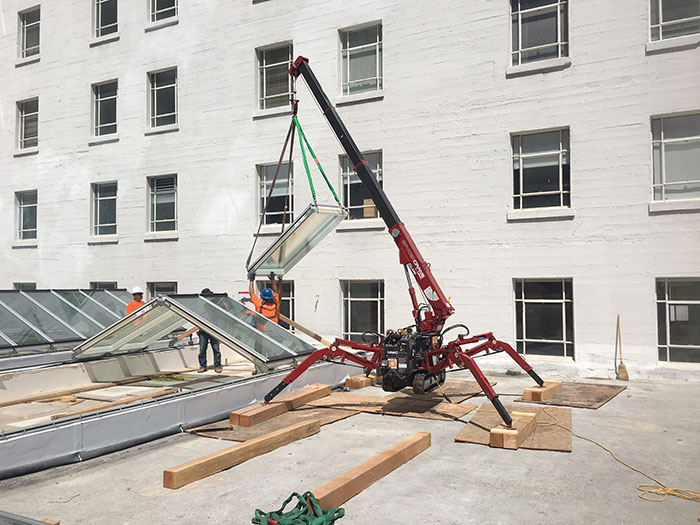 Installers used a spider crane to move the VMS ridgelight modules into place