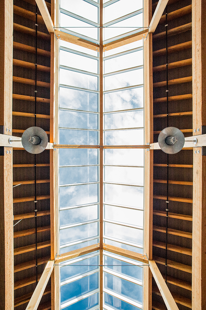 Looking up at the blue sky through VELUX Modular Skylight Solution